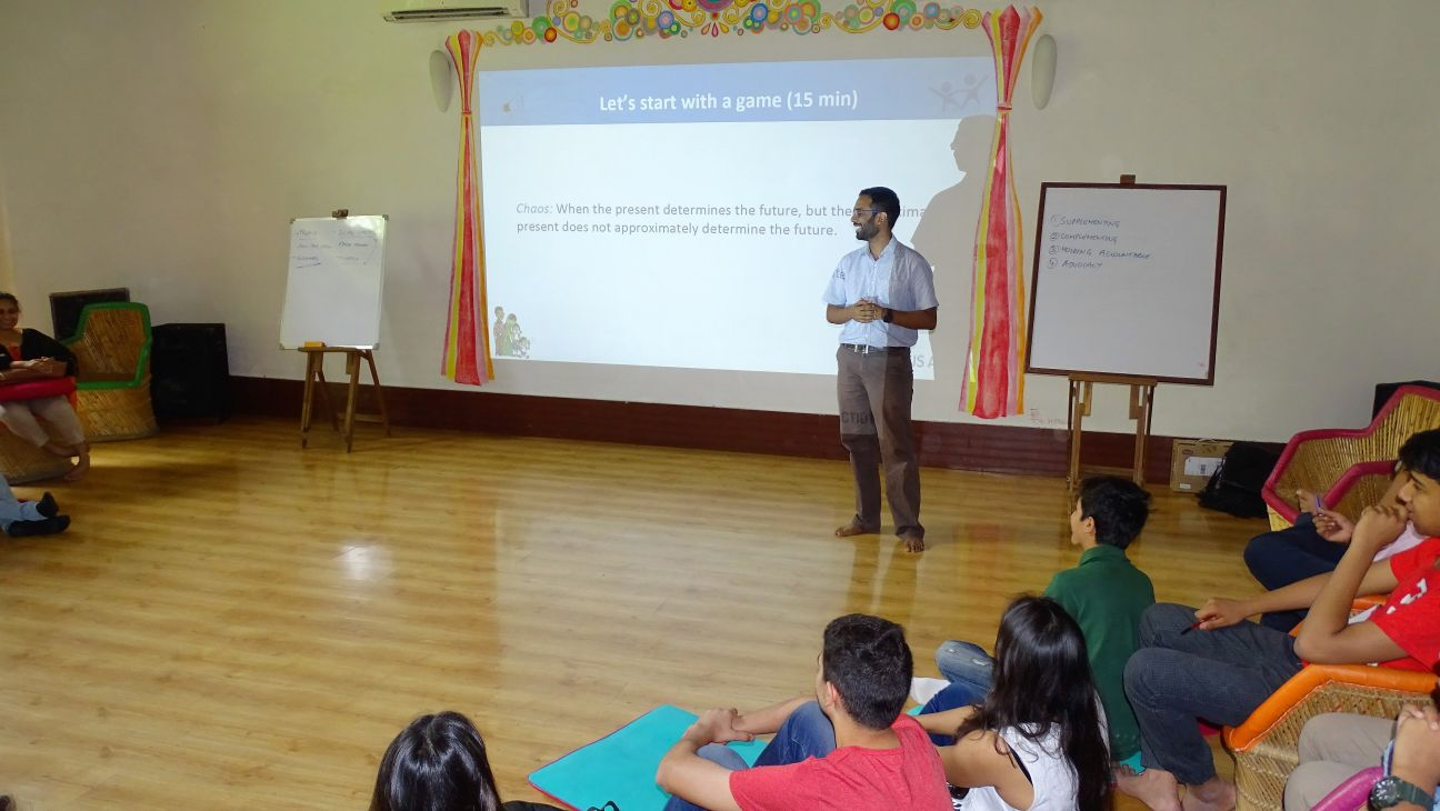 Indus Action founder and CEO Tarun Cherukuri speaks to the students