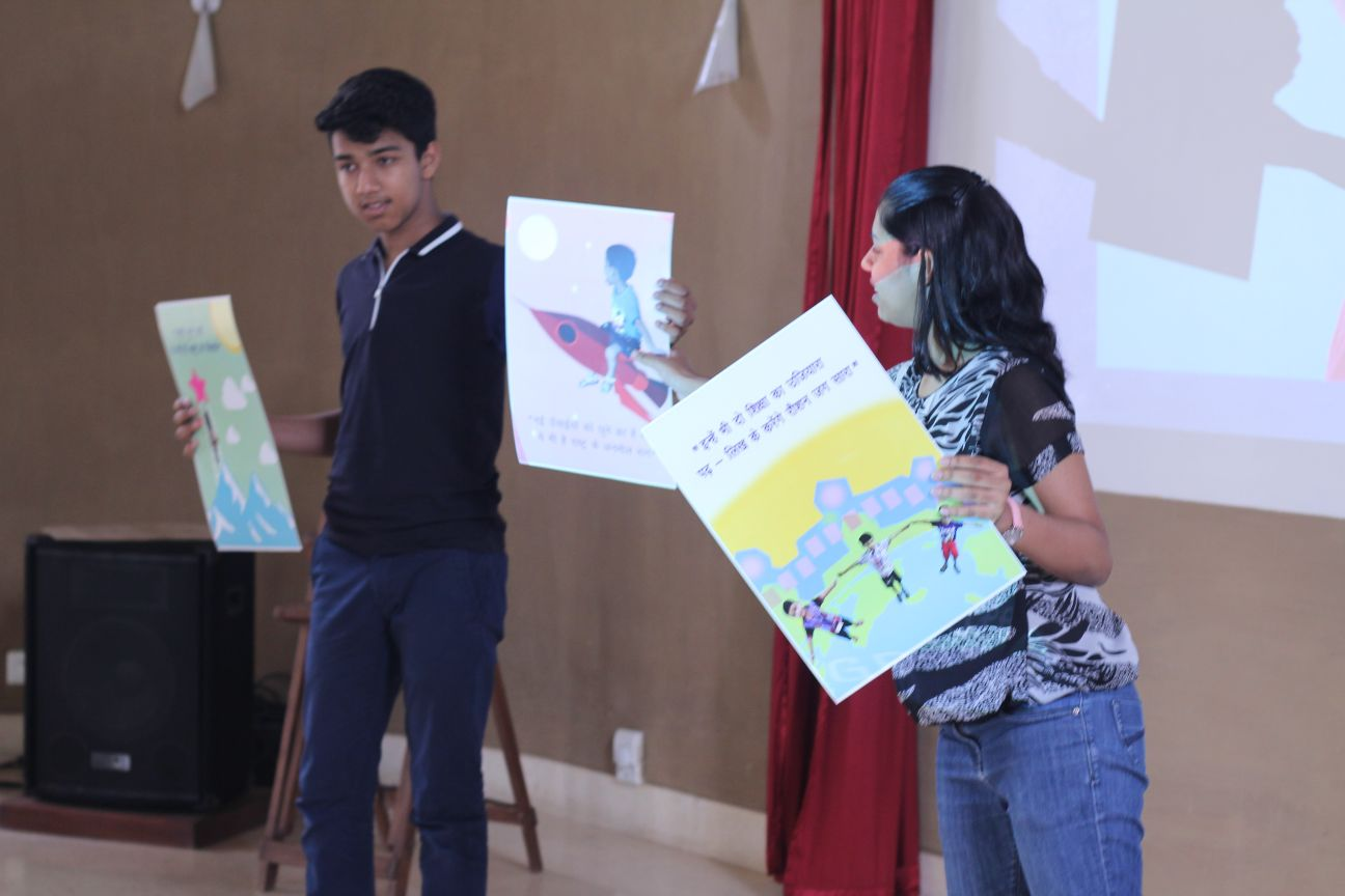 Jayansh and Surabhi presenting the posters they made for their NGO Indus Action